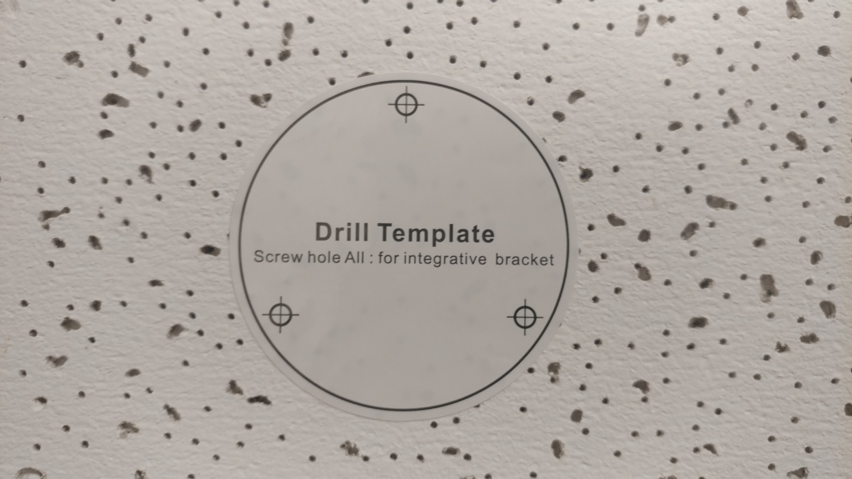 place drill template on ceiling tile